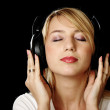 Blonde girl in headphones with eyes closed — Stock Photo #3252683
