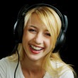 Cheerful laughing blonde girl in headphones — Stock Photo #3252685