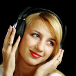 Blonde girl in headphones — Stock Photo #3252686