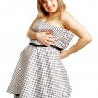 Pregnant woman tries to fit the dress — Stock Photo