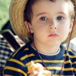 Small boy in straw hat daydreams — Stock fotografie #3261696