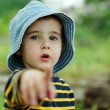 Little boy points to the camera — Stock Photo