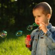 Little boy makes bubbles — Stock Photo