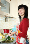 Happy woman coocking vegetables — Stock Photo