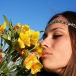 Royalty-Free Stock Photo: Hippie girl smells lily