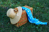 Straw hat, basket and neckerchief — Stock Photo