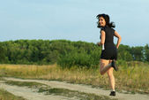 Woman jogging outdoors turn around — Stock Photo