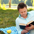 Royalty-Free Stock Photo: Young man reads book