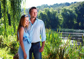 Loving couple on the river shore — Stock Photo