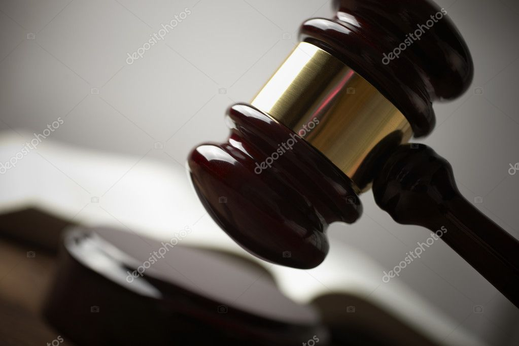 Juridical concept with hammer and lawbook, selective focus on metal part,toned f/x — Stockfoto #3195825