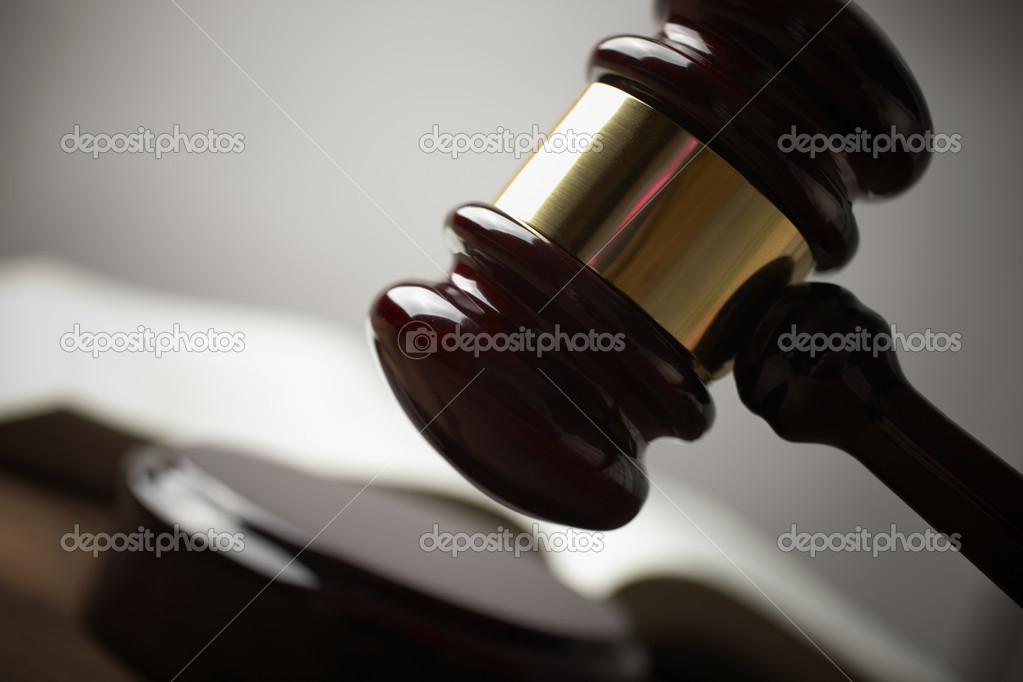 Juridical concept with hammer and lawbook, selective focus on metal part,toned f/x  Stock fotografie #3195825