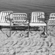 Elbow-chairs on the beach — Stock Photo