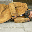 Royalty-Free Stock Photo: Homeless person sleep on the street