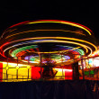 Bright lights of merry-go-round - Stock Photo