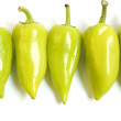 Five green peppers — Stock Photo