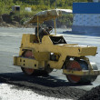 Yellow road-roller - Stock Photo