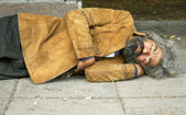 Homeless person sleep on the street — Stock Photo