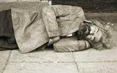 Homeless person sleep on the street — Stock Photo