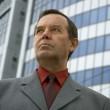 Businessman in front of a building — Stock Photo