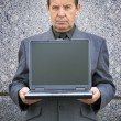 Stock Photo: Businessman and laptop with empty screen