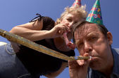 Happy noisemakers on the party — Foto Stock