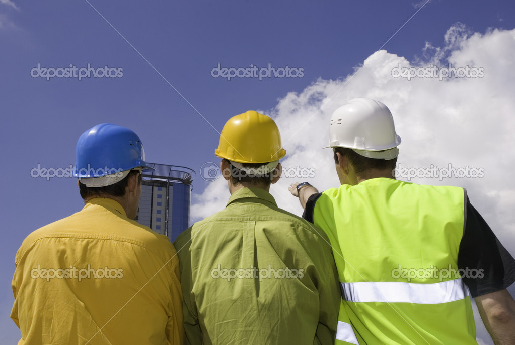 Three workers on sky background (focus point on center) — Stock Photo #3270725