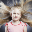 Little girl with the developing hair1 — Stock Photo
