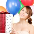 Party girl with balloons and gift box — Stock Photo #3248447