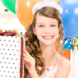 Royalty-Free Stock Photo: Party girl with balloons and gift box