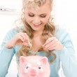 Lovely woman with piggy bank and money — Stock Photo #3249450