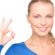 Lovely woman showing ok sign — Stock Photo #3249892