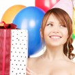 Party girl with balloons and gift box — Stock Photo #3249962