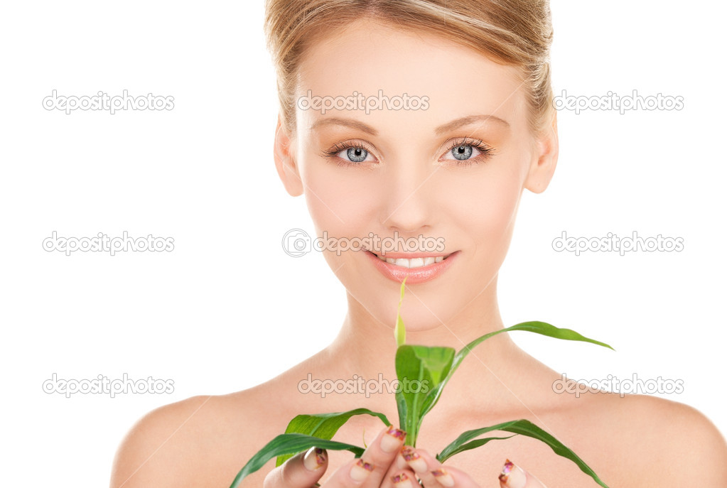 Picture of woman with sprout over white — Stock Photo #3248102