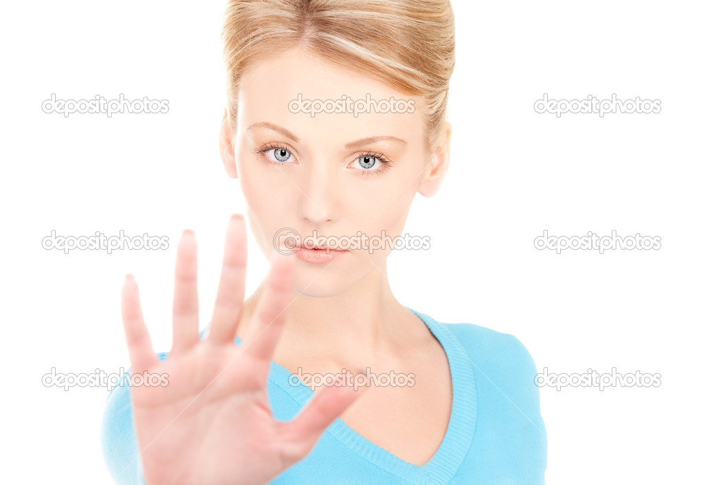 Bright picture of young woman making stop gesture  Stock Photo #3248110