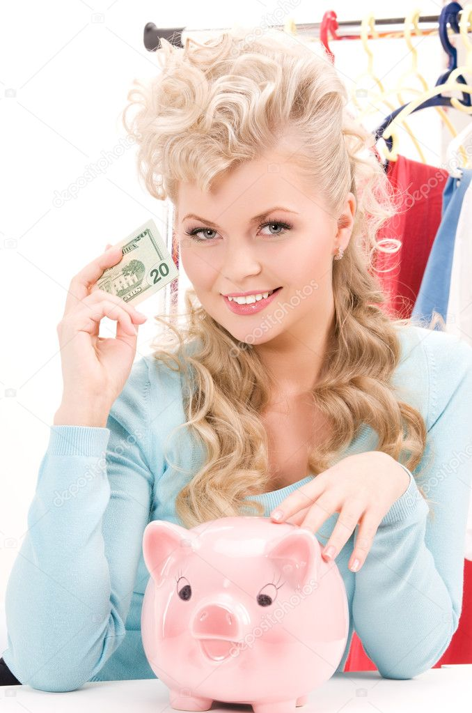 Picture of lovely woman with piggy bank and money — Stock Photo #3248127