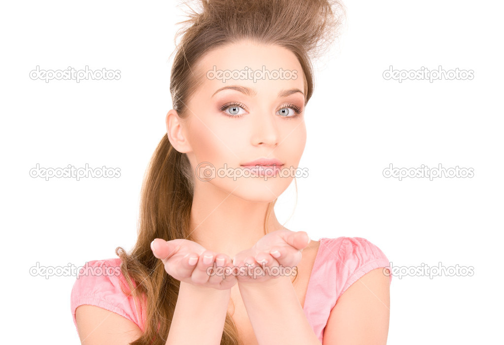 Beautiful woman showing something on the palms of her hands  Stock Photo #3248178