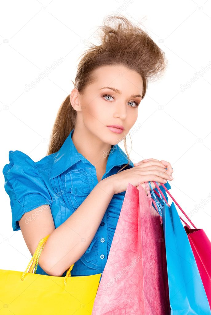 Lovely woman with shopping bags over white — Stock Photo #3248194