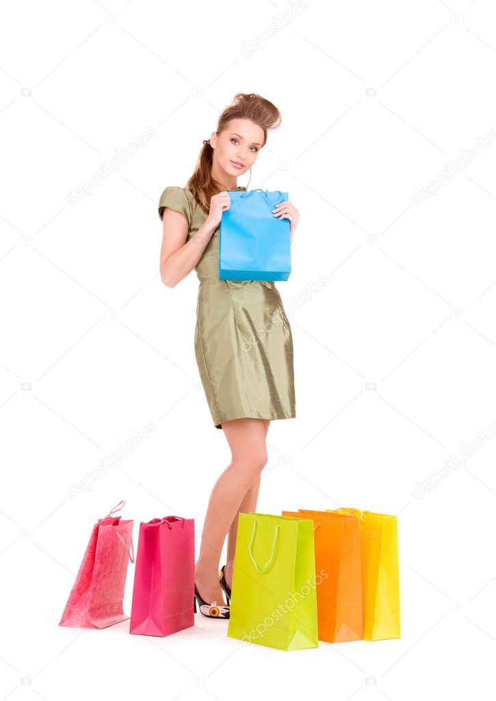 Lovely woman with shopping bags over white  Stock Photo #3248229