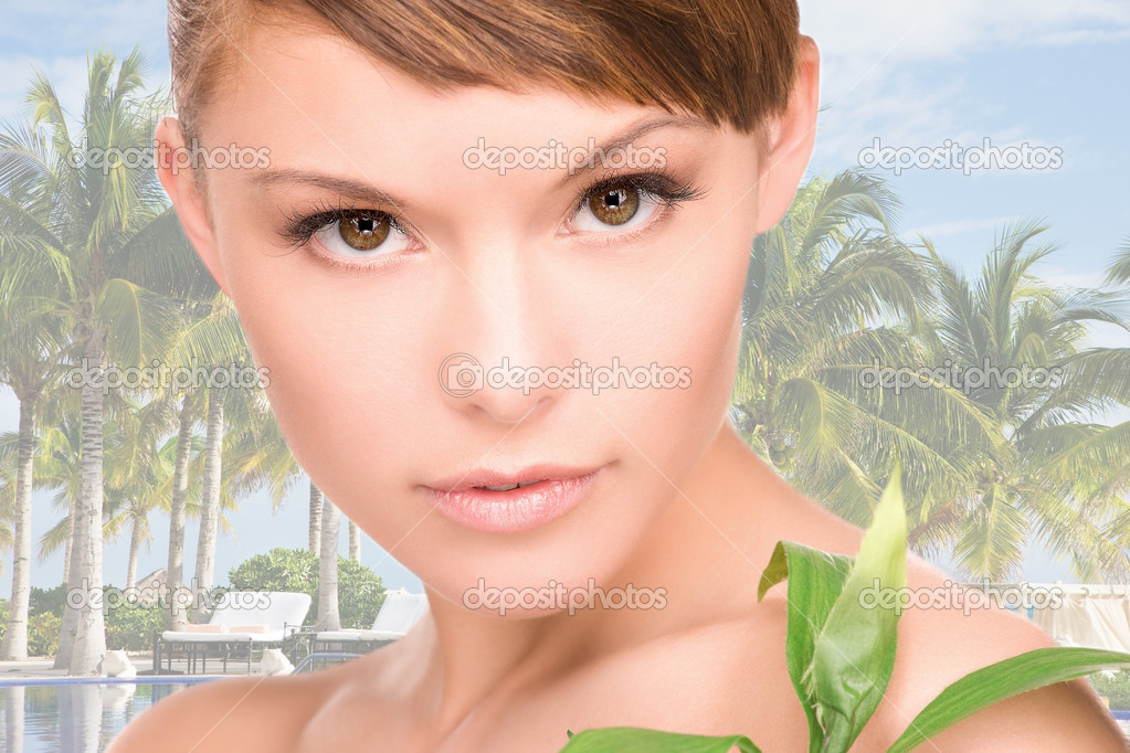 Picture of woman with sprout over tropical background — Stock Photo #3248431