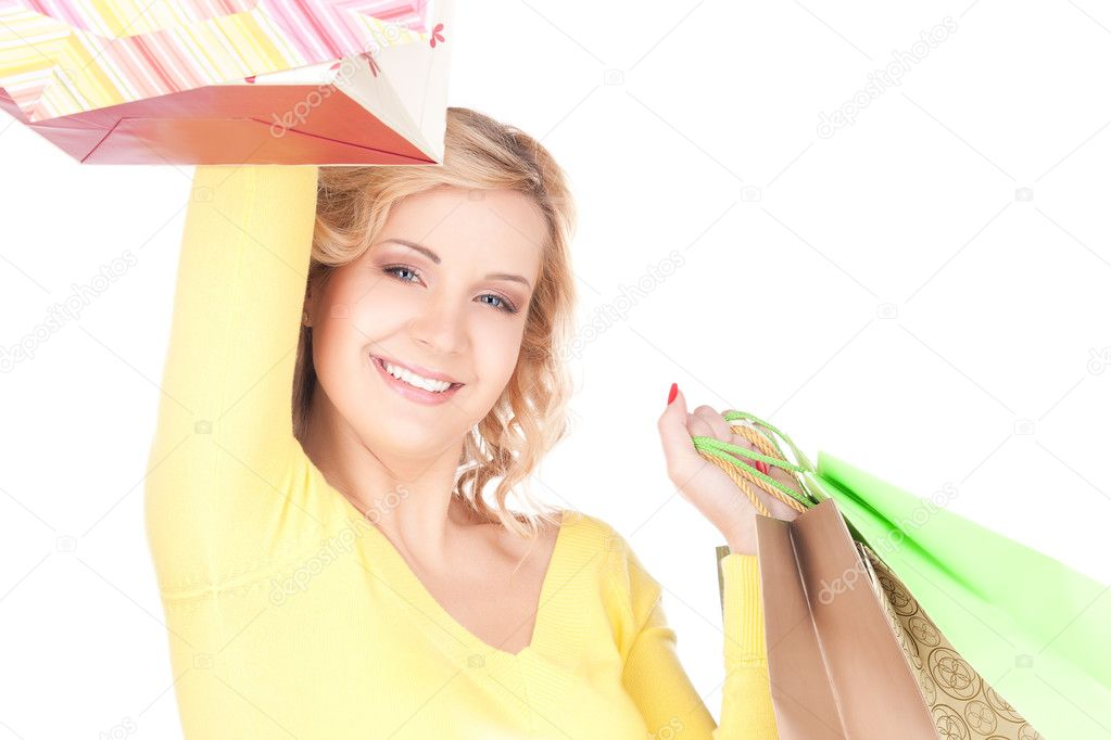 Happy woman with shopping bags over white — Stock Photo #3248469
