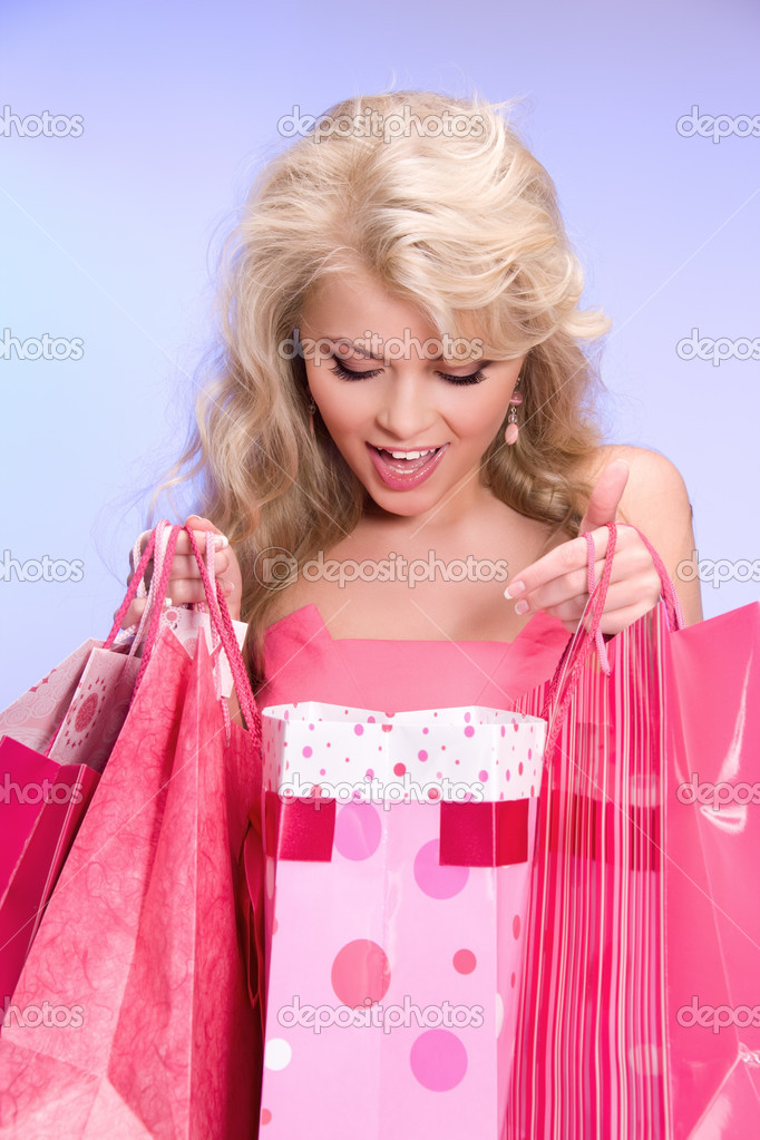 Lovely woman with shopping bags over blue  Stock Photo #3248569