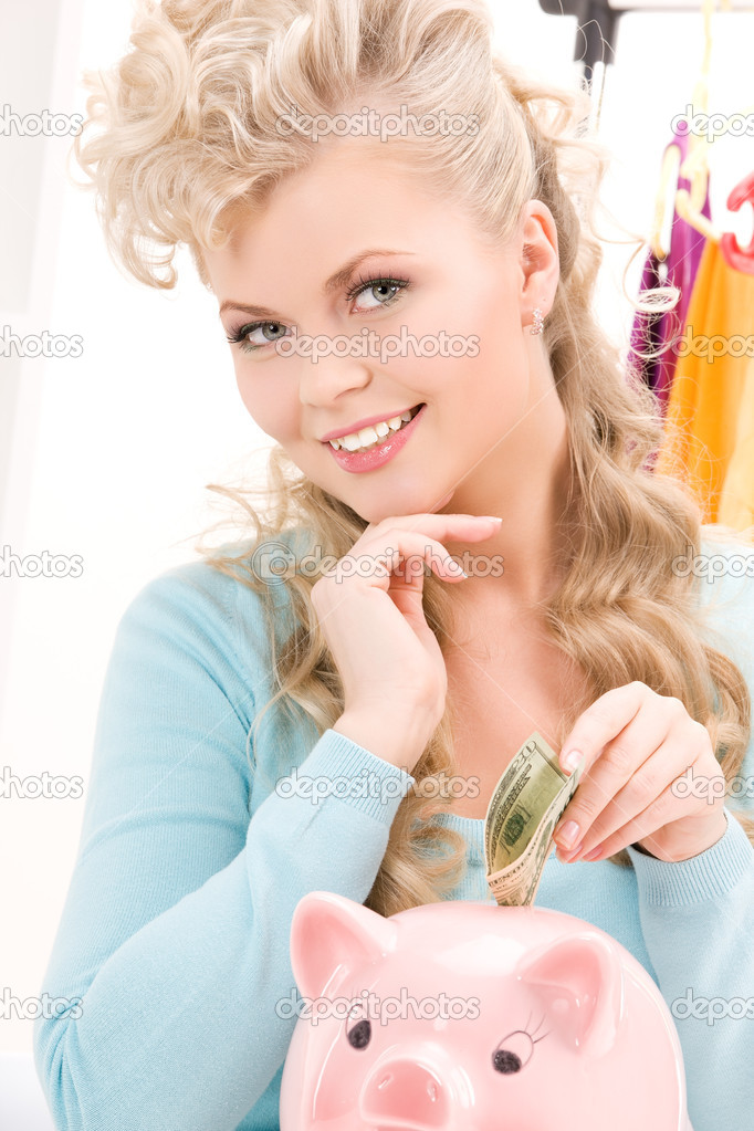 Picture of lovely woman with piggy bank and money — Stock Photo #3248821