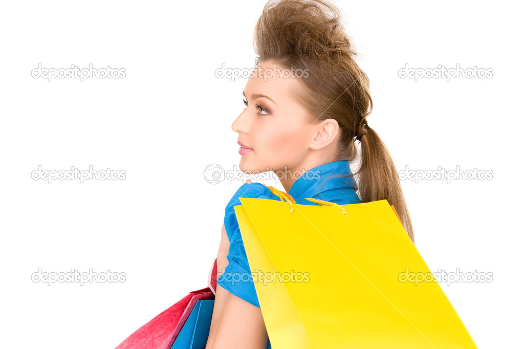 Lovely woman with shopping bags over white — Stock Photo #3248872