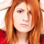 Unhappy redhead woman — Stock Photo