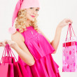 Royalty-Free Stock Photo: Cheerful santa helper girl with shopping bags