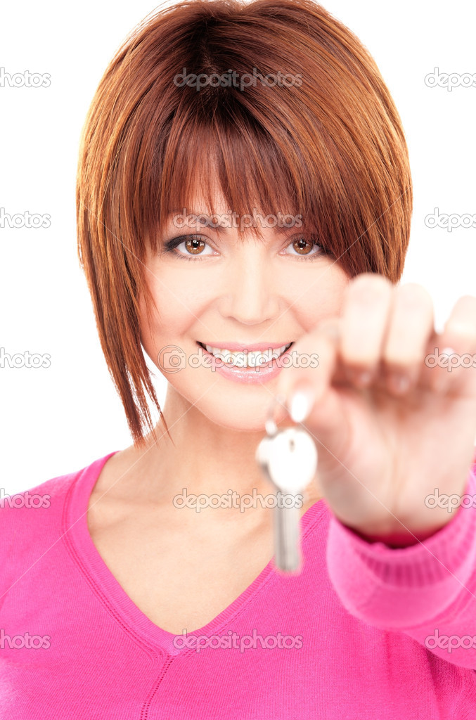 Picture of happy woman with keys over white — Stock Photo #3251463