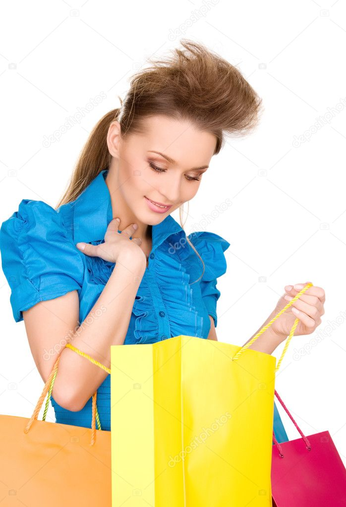 Lovely woman with shopping bags over white — Stock Photo #3251980