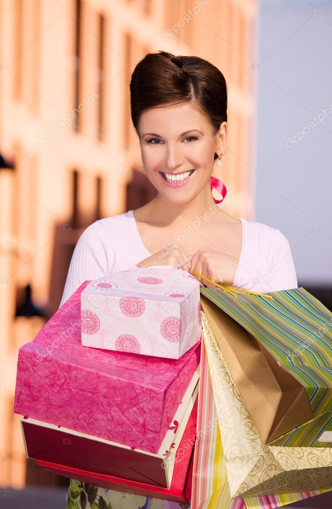 Outdoor picture of happy woman with shopping bags  Stock Photo #3254960