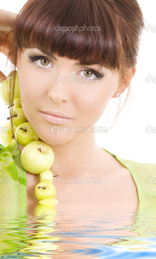 Picture of beautiful woman with green apples in water — Stock Photo #3255372