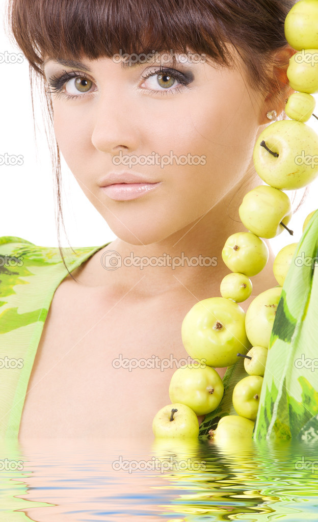 Picture of beautiful woman with green apples in water — Stock Photo #3255855